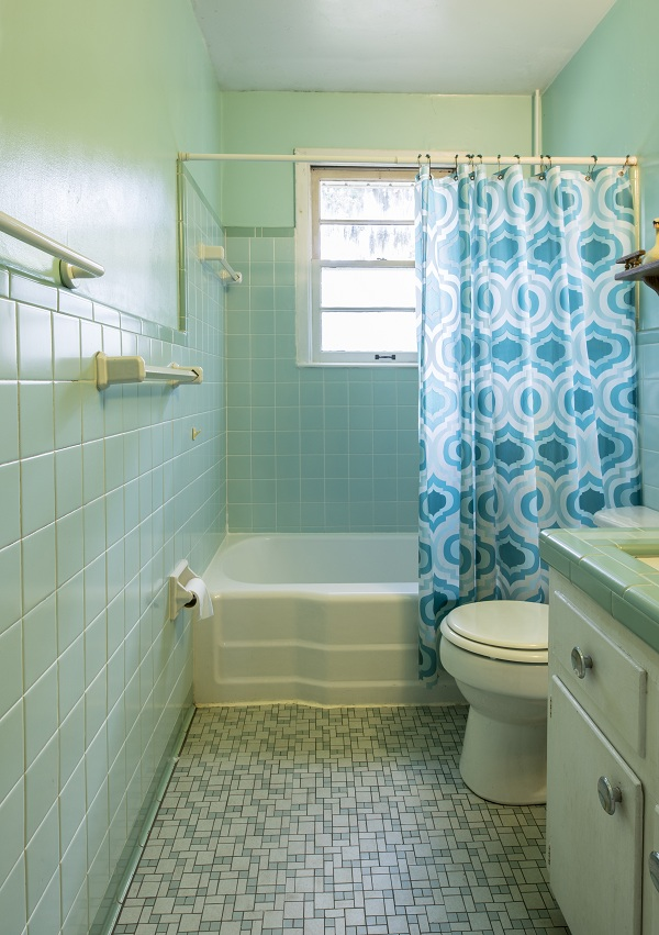 mini bathroom in green tiles